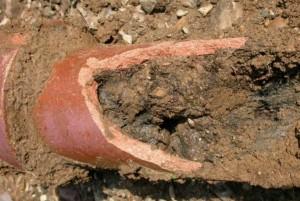 pipe damaged full of mud